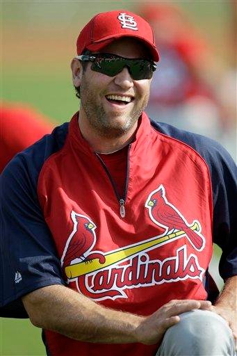 St. Louis Cardinals' Lance Berkman laughs as he stretches with teammates during baseball spring training on Sunday, Feb. 20, 2011, in Jupiter, Fla. (AP Photo/Jeff Roberson) By Jeff Roberson