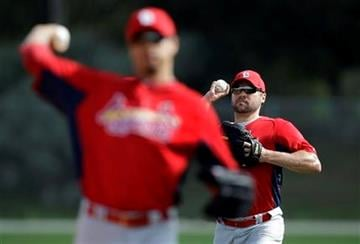 St. Louis Cardinals starting pitchers Kyle Lohse, left, and Jake Westbrook warm up during spring training baseball Sunday, Feb. 27, 2011, in Jupiter, Fla. (AP Photo/Jeff Roberson) By Jeff Roberson