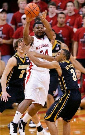 Nebraska's Lance Jeter passes the ball over the defense of Missouri's Ricky Kreklow (2) and Matt Pressey (3) in the first half of their NCAA college basketball game in Omaha, Neb., Tuesday, March 1, 2011. (AP Photo/Nati Harnik) By Nati Harnik