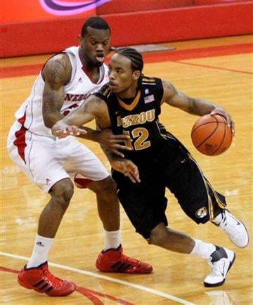 Missouri's Marcus Denmon (12) drives around Nebraska's Caleb Walker in the first half of their NCAA college basketball game in Omaha, Neb., Tuesday, March 1, 2011. (AP Photo/Nati Harnik) By Nati Harnik