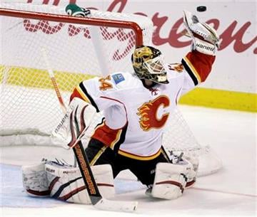 Calgary Flames goalie Miikka Kiprusoff deflects the puck with his glove in the second period of an NHL hockey game against the St. Louis Blues, Tuesday, March 1, 2011, in St. Louis.(AP Photo/Tom Gannam) By Tom Gannam