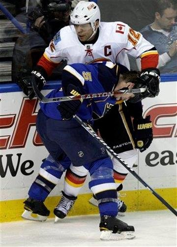 St. Louis Blues' Barret Jackman (5) pins Calgary Flames' Jarome Iginla (12) against the boards in the second period of an NHL hockey game Tuesday, March 1, 2011, in St. Louis.(AP Photo/Tom Gannam) By Tom Gannam