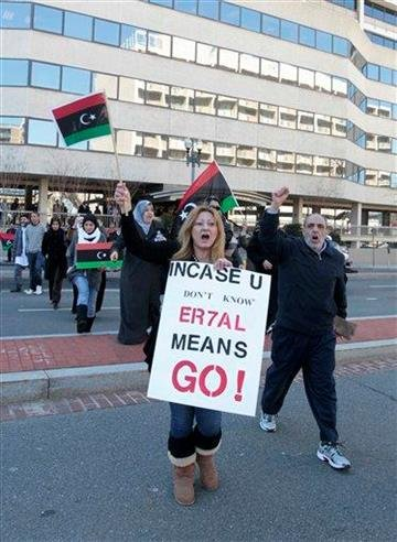 A small group of anti- Gadhafi protestors take part in a demonstration at the Libyan Embassy in Washington, Tuesday, March 1, 2011. (AP Photo/Luis M. Alvarez) By Luis Alvarez