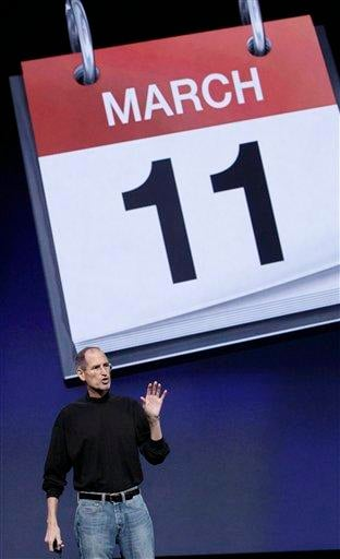 Apple Inc. Chairman and CEO Steve Jobs stands under an image for the release date of the iPad 2 at an Apple event at the Yerba Buena Center for the Arts Theater in San Francisco, Wednesday, March 2, 2011. (AP Photo/Jeff Chiu) By Jeff Chiu