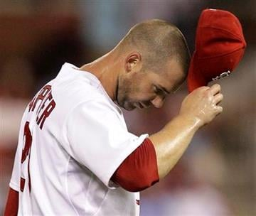 St. Louis Cardinals starting pitcher Chris Carpenter adjusts his cap while working during the first during of a baseball game against the Chicago Cubs on Wednesday, Sept. 15, 2010, in St. Louis. (AP Photo/Jeff Roberson) By Jeff Roberson