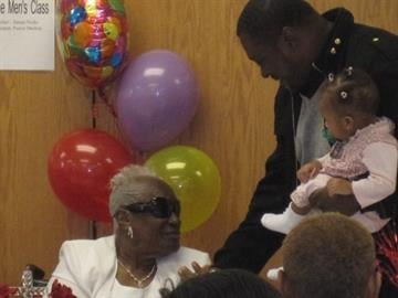 Supercentenarian Leola Washington greets a young child as she celebrates her 110th birthday at Union Tabernacle Missionary Baptist Church on March 2, 2011. By KMOV Web Producer