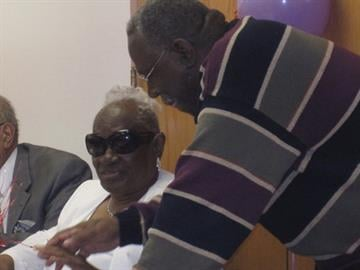 Carl Lewis Sr. holds the hand of Mrs. Leola Washington after singing a special solo for her 110th birthday celebration on March 2, 2011 at Union Tabernacle Missionary Baptist Church in north St. Louis. By KMOV Web Producer