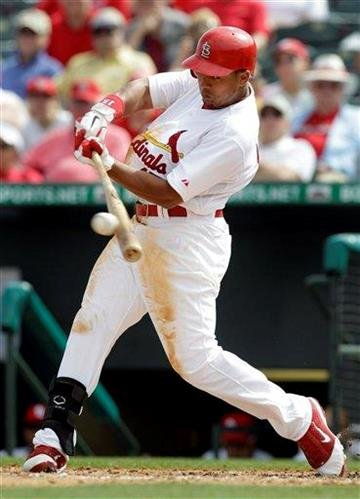 St. Louis Cardinals' Jon Jay hits a single during the fifth inning of a spring training baseball game against the New York Mets Wednesday, March 2, 2011, in Jupiter, Fla. (AP Photo/Jeff Roberson) By Jeff Roberson