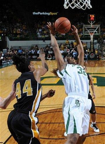 Baylor forward Brooklyn Pope (32) reaches back for a rebound against Missouri forward Shakara Jones (44) during the first half of an NCAA college basketball game Wednesday, March 2, 2011, in Waco, Texas. (AP Photo/Tony Gutierrez) By Tony Gutierrez