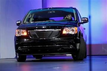 A newly refined Chrysler Town and Country minivan is driven at the 2010 Los Angeles Auto Show, Thursday, Nov. 18, 2010, in Los Angeles. (AP Photo/Damian Dovarganes) By Damian Dovarganes