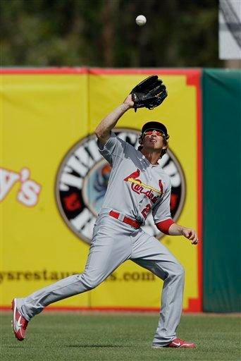 St. Louis Cardinals center fielder Colby Rasmus catches a fly ball hit by Houston Astros' Angel Sanchez during the second inning of a spring training baseball game Friday, March 4, 2011, in Kissimmee, Fla. (AP Photo/David J. Phillip) By David J. Phillip