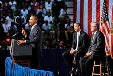 President Barack Obama, accompanied by former Florida Gov. Jeb Bush, right, and Education Secretary Arne Duncan, speaks at Miami Central Senior High School in Miami, Friday, March. 4, 2011. (AP Photo/Steve Mitchell) By Steve Mitchell