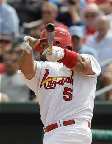 St. Louis Cardinals' Albert Pujols (5) bats during a spring training baseball game against the Houston Astros, Saturday, March 5, 2011 in Jupiter, Fla. (AP Photo/Carlos Osorio) By Carlos Osorio
