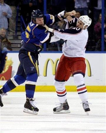 St. Louis Blues' Cam Janssen (55) fights with Columbus Blue Jackets' Jared Boll (40) in the first period of an NHL hockey game, Monday, March 7, 2011, in St. Louis. (AP Photo/Tom Gannam) By Tom Gannam