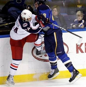 St. Louis Blues' David Backes (42) collides with Columbus Blue Jackets' Derek MacKenzie (24) in overtime of an NHL hockey game Monday, March 7, 2011 in St. Louis. The Blues beat the Blue Jackets 5-4 in a shootout. (AP Photo/Tom Gannam) By Tom Gannam