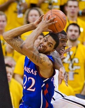Kansas' Marcus Morris, left, pulls down a rebound over Missouri's Ricardo Ratliffe, right, during the first half of an NCAA college basketball game Saturday, March 5, 2011, in Columbia, Mo.  (AP Photo/L.G. Patterson) By L.G. Patterson