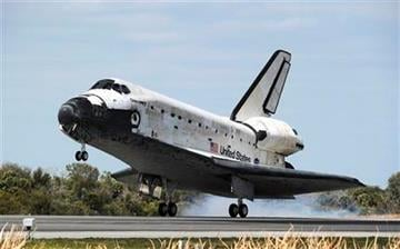 Space shuttle Discovery lands at the Kennedy Space Center in Cape Canaveral, Fla., Wednesday, March 9, 2011. (AP Photo/Stan Honda, Pool) By Stan Honda