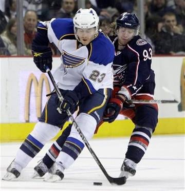 St. Louis Blues' Ian Cole, left, and Columbus Blue Jackets' Jakub Voracek, of the Czech Republic, chase a loose puck during the first period of an NHL hockey game on Wednesday, March 9, 2011, in Columbus, Ohio. (AP Photo/Jay LaPrete) By Jay LaPrete