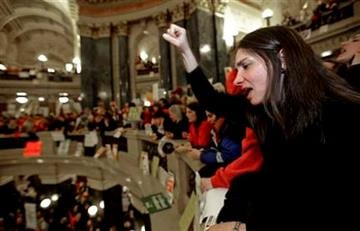 Kristin Mattis of Madison, Wis., protests at the state Capitol in Madison, Wis., Wednesday, March 9, 2011., after demonstrators retook over the state Capitol in Madison, Wis., Wednesday, March 9, 2011. By Andy Manis