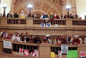 Opponents to the governor's bill to eliminate collective bargaining rights for many state workers have retaken the state Capitol in Madison, Wis., Wednesday, March 9, 2011. (AP Photo/Andy Manis) By Andy Manis