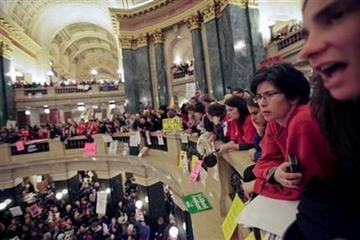 Opponents to the governor's bill to eliminate collective bargaining rights for many state workers have retaken over the state Capitol in Madison, Wis., Wednesday, March 9, 2011. (AP Photo/Andy Manis) By Andy Manis