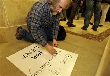 Union supporter Rolind Pagano of Belleville, Wis., writes a sign out at the state Capitol in Madison, Wis., Wednesday, March 9, 2011, after demonstrators retook the Capitol building. (AP Photo/Andy Manis) By Andy Manis
