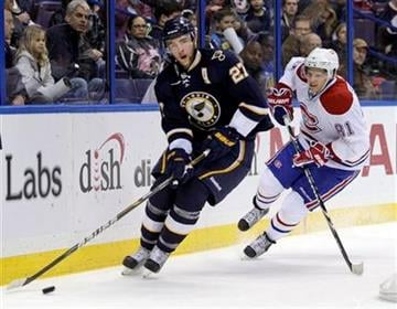 St. Louis Blues' Alex Pietrangelo (27) controls the puck in front of Montreal Canadiens' Lars Eller (81) during the first period of an NHL hockey game, Thursday, March 10, 2011 in St. Louis.(AP Photo/Tom Gannam) By Tom Gannam