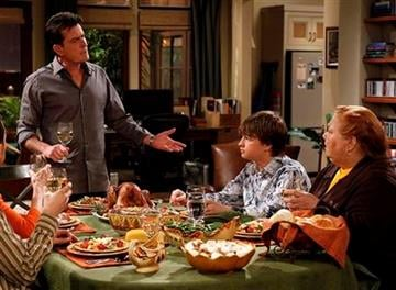 """In this undated publicity image released by CBS, from left, Charlie Sheen, Angus T. Jones and Conchata Ferrell are shown during the taping of """"Two and a Half Men,"""" in Los Angeles. (AP Photo/CBS, Greg Gayne) By Greg Gayne"""