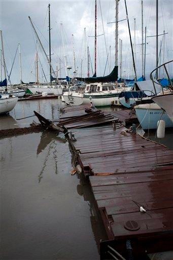 A damaged pier is shown after a tsunami hit Hawaii on Friday, March 11, 2011 in Honolulu. A tsunami generated by an 8.9-magnitude earthquake in Japan hit Oahu causing some damage around the island. (AP Photo/Marco Garcia) By Marco Garcia