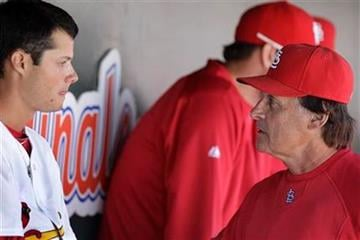 St. Louis Cardinals manager Tony La Russa, right, talks with pitcher Joe Kelly after getting pulled during a spring training baseball game against the Detroit Tigers, Friday, March 11, 2011, in Jupiter, Fla. (AP Photo/Carlos Osorio) By Carlos Osorio