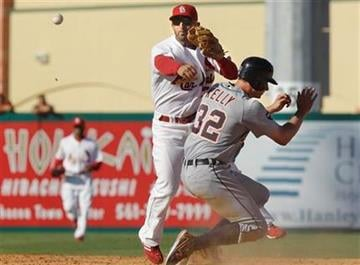 Detroit Tigers' Don Kelly (32) is tagged out by St. Louis Cardinals shortstop Pete Kozma (88) during a spring training baseball game, Friday, March 11, 2011, in Jupiter, Fla. (AP Photo/Carlos Osorio) By Carlos Osorio