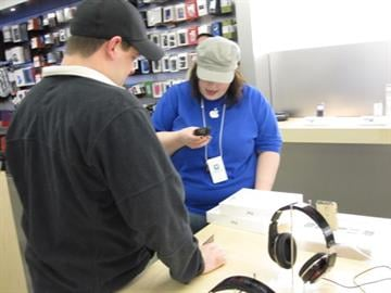 An Apple store employee rings up two new iPad 2s for Shaun Hautly, the first customer to buy an iPad 2 on the day of its release at the St. Louis Galleria (March 11, 2011). By KMOV Web Producer