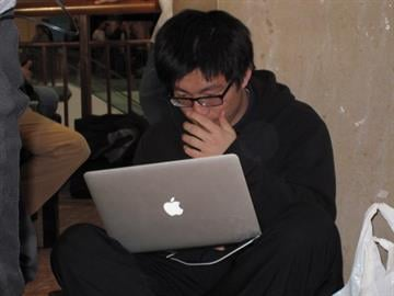 Hongye Sun, 21, sits in line for the Apple iPad 2 with his laptop at the St. Louis Galleria. The iPad 2 was released on March 11, 2011. By KMOV Web Producer