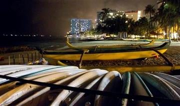 Surf boards and Hawaiian outrigger canoes sit on a deserted Waikiki Beach early Friday, March 11, 2011 in Honolulu. The state of Hawaii is under a tsunami warning due to an 8.9-magnitude earthquake that hit Japan. (AP Photo/Eugene Tanner) By Eugene Tanner