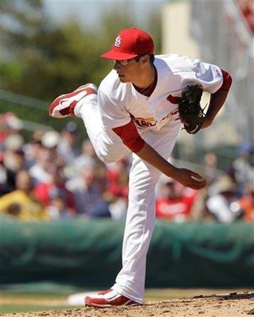 St. Louis Cardinals pitcher Joe Kelly throws during a spring training baseball game against the Detroit Tigers, Friday, March 11, 2011, in Jupiter, Fla. (AP Photo/Carlos Osorio) By Carlos Osorio