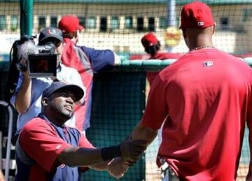 Boston Red Sox's David Ortiz, left, talks to St. Louis Cardinals' Albert Pujols before a spring training baseball game, Tuesday, March 8, 2011 in Jupiter, Fla. (AP Photo/Carlos Osorio) By Carlos Osorio