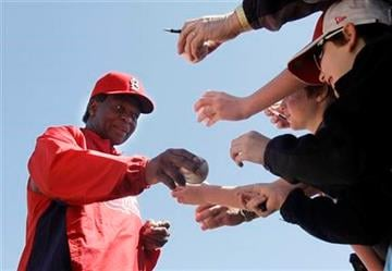 St. Louis Cardinals Hall of Famer Lou Brock signs autographs before a spring training baseball game against the Detroit Tigers, Friday, March 11, 2011, in Jupiter, Fla. (AP Photo/Carlos Osorio) By Carlos Osorio