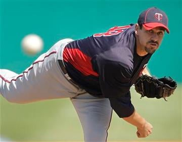 Minnesota Twins starting pitcher Carl Pavano throws during a spring training baseball game against the St. Louis Cardinals, Saturday, March 12, 2011, in Jupiter, Fla. (AP Photo/Carlos Osorio) By Carlos Osorio