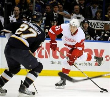 Detroit Red Wings' Valtteri Filppula (51), of Finland, shoots around St. Louis Blues' Alex Pietrangelo (27) in the first period of an NHL hockey game, Saturday, March 12, 2011, in St. Louis. (AP Photo/Bill Boyce) By Bill Boyce