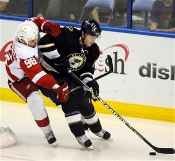 Detroit Red Wings' Tomas Holmstrom (96), of Sweden, reaches across St. Louis Blues' Ian Cole, right, in the third period of an NHL hockey game, Saturday, March 12, 2011, in St. Louis. The Red Wings won 5-3. (AP Photo/Bill Boyce) By Bill Boyce