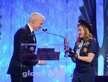 NEW YORK, NY - MARCH 16:  Anderson Cooper and Madonna speak onstage at the 24th Annual GLAAD Media Awards on March 16, 2013 in New York City.  (Photo by Jamie McCarthy/Getty Images for GLAAD) By Jamie McCarthy