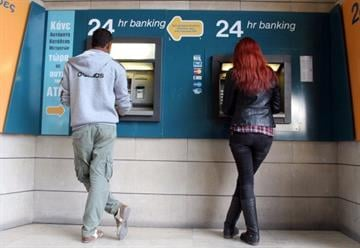 Cyprus' residents rushed to withdraw cash ahead of a vote today on a plan that would tax deposits in the country's banks to save it from bankruptcy. By HASAN MROUE