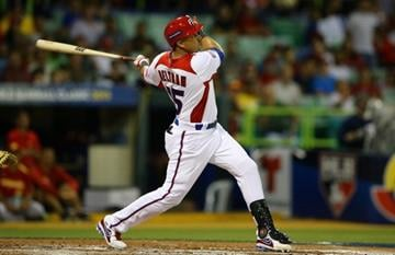 SAN JUAN, PUERTO RICO - MARCH 08:  Carlos Beltran #15 of Puerto Rico bats against  Spain during the first round of the World Baseball Classic at Hiram Bithorn Stadium on March 8, 2013 in San Juan, Puerto Rico.  (Photo by Al Bello/Getty Images) By Al Bello