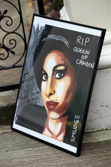 LONDON, UNITED KINGDOM - JULY 26: A picture of Amy Winehouse is left in tribute outside her home in Camden Square on the day of her funeral on July 26, 2011 in London, England. (Photo by Neil Mockford/Getty Images) By Neil Mockford