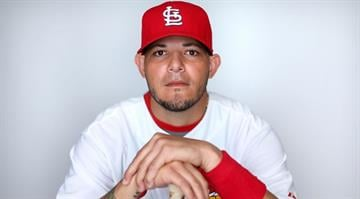 JUPITER, FL - FEBRUARY 19:  Yadier Molina #4 of the St. Louis Cardinals poses during photo day at Roger Dean Stadium on February 19, 2013 in Jupiter, Florida.  (Photo by Mike Ehrmann/Getty Images) By Eric Lorenz
