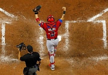 MIAMI, FL - MARCH 15:  Yadier Molina #4 of Puerto Rico reacts to winning a World Baseball Classic second round game against the United States at Marlins Park on March 15, 2013 in Miami, Florida.  (Photo by Mike Ehrmann/Getty Images) By Mike Ehrmann
