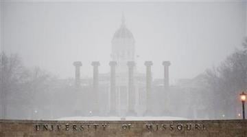 FILE -- Snow falls on the empty University of Missouri quadrangle Tuesday, Feb. 1, 2011, in Columbia. Mo. The university closed campus on Tuesday due to an approaching blizzard. (AP Photo/L.G. Patterson) By L.G. Patterson
