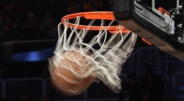 A generic view of a basketball going through the hoop. (Photo by Bruce Bennett/Getty Images) By Bruce Bennett