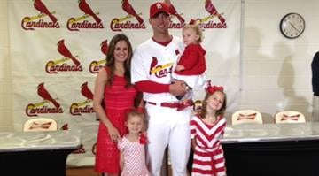 Wainwright and his family pose for cameras during a press conference announcing a five-year extension between him and the Cardinals. By Brendan Marks