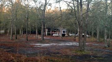 The Ellabell, Ga., property where seven pit bulls or pit bull-mix dogs attacked a 2-year-old girl. / WTOC By Belo Content KMOV